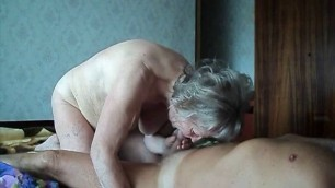 Grandma and Grandpa fuck fuck in bed in a doggy style pose