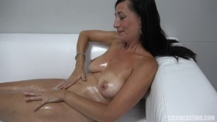 Denisa 8375 mature woman plastering her body with oil on porn casting