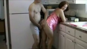 Crazy Mature Wife with a plump body fucks with a man in the kitchen video